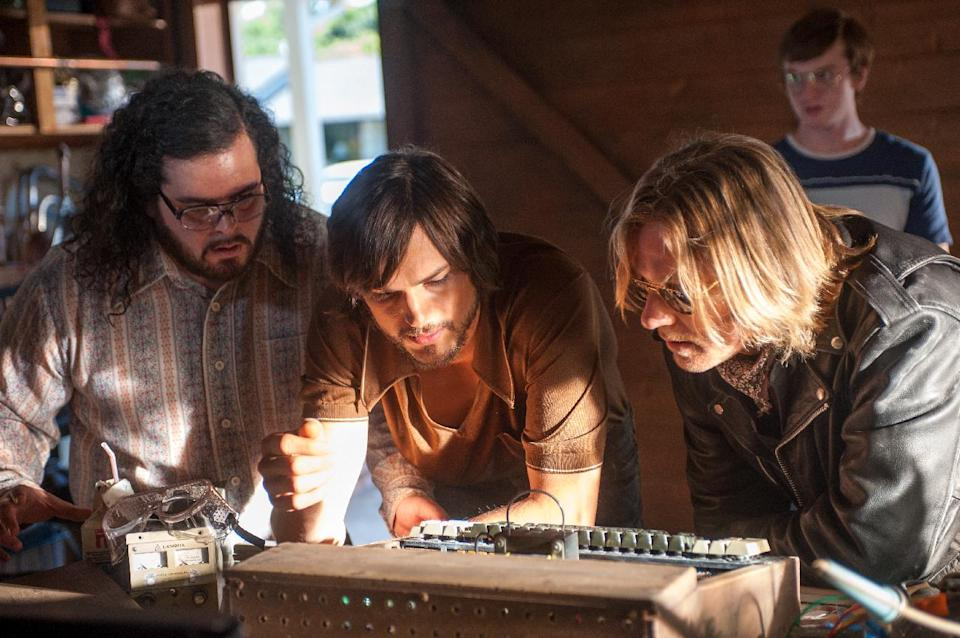 "This film image released by Open Road Films shows, from left, Josh Gad as Steve Wozniak, Ashton Kutcher as Steve Jobs, and Ron Eldard as Rod Holt in a scene from ""Jobs."" (AP Photo/Open Road Films, Glen Wilson)"