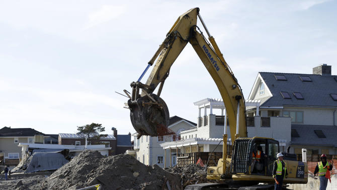 The remains of a house damaged by Superstorm Sandy and then bulldozed by a contractor are removed from the beach in the Belle Harbor section of the Rockaways, as cleanup from the storm continues Thursday, Jan. 10, 2013, in New York. (AP Photo/Kathy Willens)