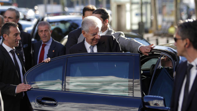 Italy's Prime Minister Mario Monti, centre, leaves the Spain-Italy Forum at American House in Madrid, Spain, Monday, Oct. 29, 2012. (AP Photo/Andres Kudacki)