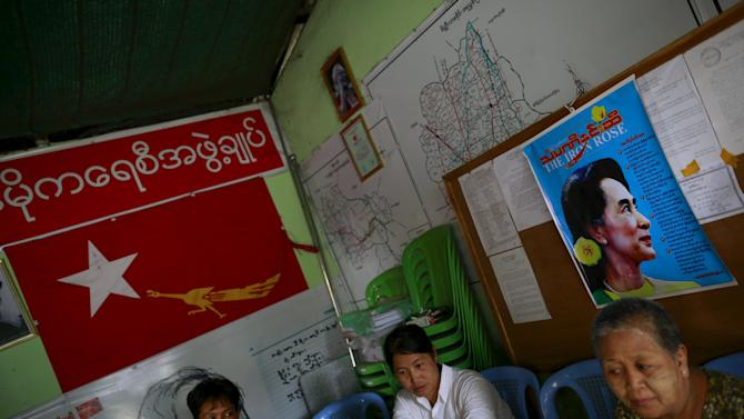 Members of National League for Democracy (NLD) party look on in their party office at Meiktila