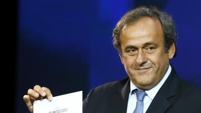 UEFA President Platini shows the name of London, one of the 13 cities which will host matches at the Euro 2020 tournament to be played across the continent, during a ceremony in Geneva
