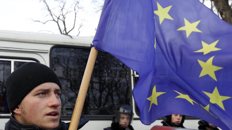 A man supporting EU integration holds a flag during a rally in Kiev