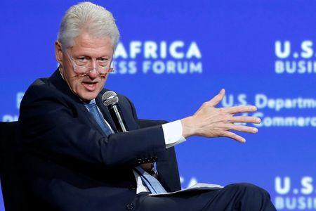 Former U.S. President Bill Clinton leads a panel discussion during the U.S.-Africa Business Forum in Washington