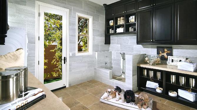 This May 13, 2014 photo provided by A.G. Photography shows a Standard Pacific Home's interior view of a dog-friendly home. Standard Pacific Homes is building and selling 27 new home communities from Florida to California and billing them as the first to offer pet paradise as an option in every one. (AP Photo/ Standard Pacific Homes, A.G. Photography, Anthony Gomez)
