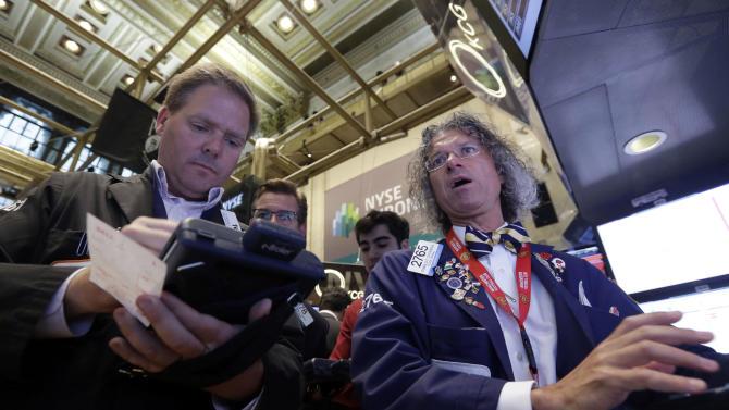 Trader Thomas McCauley, left, and specialist Donald Civitanova work on the floor of the New York Stock Exchange, Friday, May 23, 2014. Stocks inched higher early Friday in quiet trading ahead of the Memorial Day weekend. (AP Photo/Richard Drew)