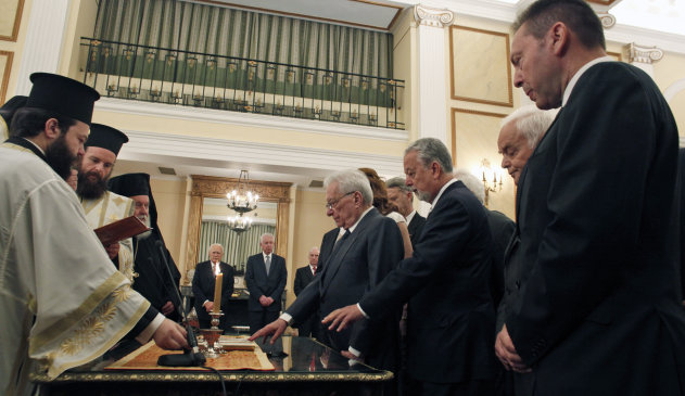 Members of the caretaker cabinet are sworn in at the Presidential Palace in Athens on Thursday May 17, 2012. Greece is swearing in the caretaker cabinet that will lead the country into repeat elections next month, after a deadlocked vote sparked more political turmoil and brought the country's euro membership into question. The 16-member cabinet was being sworn in Thursday morning, to be followed by the swearing in of the 300-member Parliament who will take up their seats for a day before Parliament is dissolved for the new vote. The deputies were elected in May. (AP Photo)