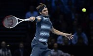 Roger Federer of Switzerland hits a return to Rafael Nadal of Spain during their men's singles semi-final tennis match at the ATP World Tour Finals at the O2 Arena in London November 10, 2013. REUTERS/Dylan Martinez