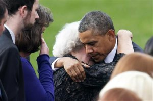 U.S. President Obama hugs a family member of a victim slain in the Washington Navy Yard shooting during a memorial service in Washington