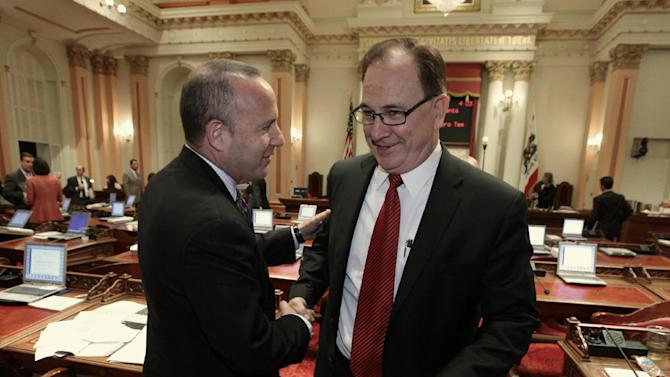 Senate Minority Leader Bob Huff, R-Diamond Bar, right, congratulates Senate President Pro Tem Darrell Steinberg, D-Sacramento, after the Senate approved a bill, that Huff opposed,  authorizing about $4.5 billion funding for a high-speed rail system  at the Capitol in Sacramento, Calif., Friday, July 6, 2012.   The bill, which would allow the state to begin selling $2.6 billion in voter -approved bonds, was approved by a 21-16 vote and now goes to Gov. Jerry Brown who has supports the measure.(AP Photo/Rich Pedroncelli)