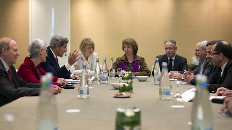 In this Nov. 9, 2013, photo, U.S. Secretary of State John Kerry, third left, meets with EU High Representative for Foreign Affairs, Catherine Ashton, center, and Iranian Foreign Minister Mohammad Javad Zarif, third right, at the Iran Nuclear talks in Geneva, Switzerland. The deadlocked international effort to sign a nuclear deal with Iran has spurred a global blame game over who walked away from the negotiating table and why. It's a war of words playing out in public statements from top officials and across social media, with a bluntness that stands in stark contrast to the secretive and diplomatic nature of the negotiations themselves. And it raises questions about whether the debate will compound the years of mistrust between Iran and the West when the parties reconvene in Geneva for another round of talks next week. (AP Photo/Jason Reed, Pool)