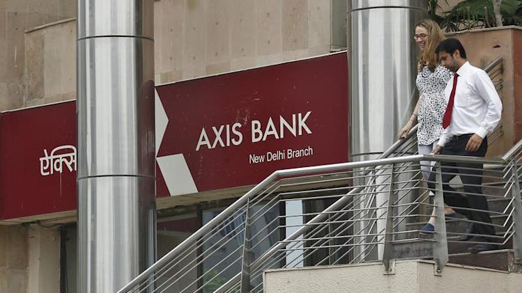People use a staircase next to a corporate branch office of Axis Bank in New Delhi
