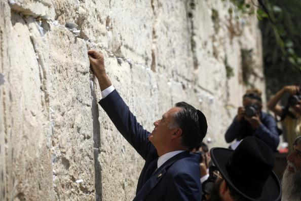US Republican presidential candidate Mitt Romney visits the Western Wall on July 29, 2012 in Jerusalem's old city, Israel. Mitt Romney visits Israel as part of a three-nation foreign tour which also includes visits to Poland and Great Britain. (Photo by Lior Mizrahi/Getty Images)