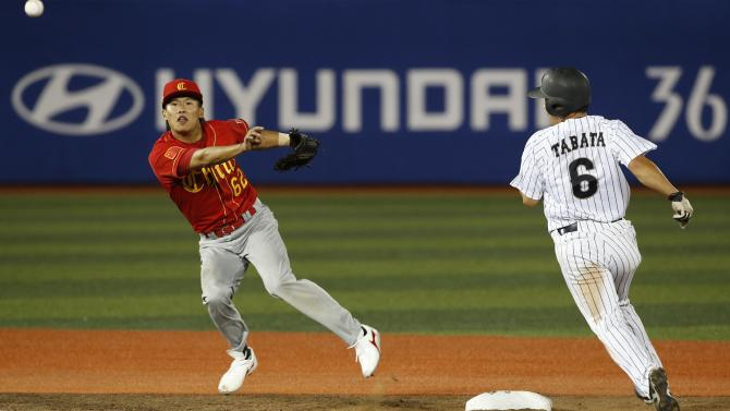 Japan's Yuichi Tabata is forced out by China's shortstop Lu Yi in the fourth inning at the men's preliminary round baseball game at the Mokdong Baseball Stadium in Seoul, during the 17th Asian Games hosted in Incheon