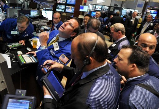 &lt;p&gt;Traders work on the floor of the New York Stock Exchange in 2011. US stocks were stuck in the red Friday, the last trading day of the third quarter, after disappointing business activity and consumer spending reports fueled concerns about the economy.&lt;/p&gt;