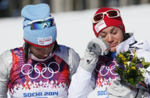 Grim talk turns to gold for now at Olympics