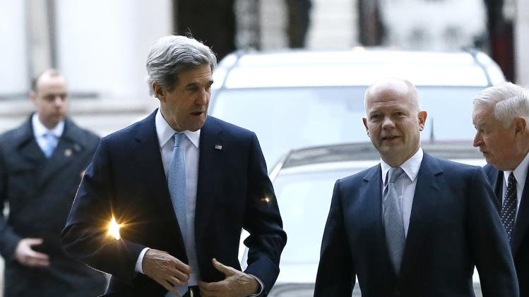 U.S. Secretary of State John Kerry, left, walks with British Foreign Secretary William Hague as he arrives at Downing Street in London, Monday, Feb. 25, 2013. (AP Photo/Kirsty Wigglesworth)