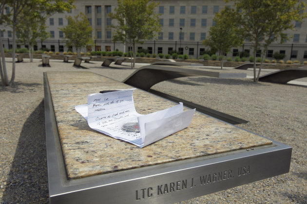 A letter saying Osama Bin Laden is dead and that the victims are not forgotten sits on the memorial bench for Lt. Col. Karen J. Wagner at the Pentagon Memorial, Monday, May 2, 2011. The Pentagon Memor