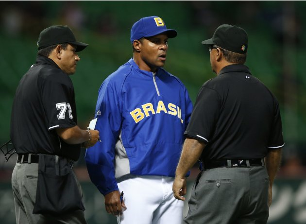 Brazil's manager Larkin talks with umpires in the eighth inning of their WBC qualifying first round game against Cuba in Fukuoka