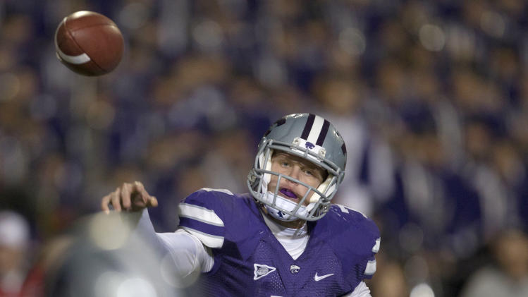 Kansas State quarterback Collin Klein passes to wide receiver Tyler Lockett during the first half of an NCAA college football game against Oklahoma State in Manhattan, Kan., Saturday, Nov. 3, 2012. (AP Photo/Orlin Wagner)