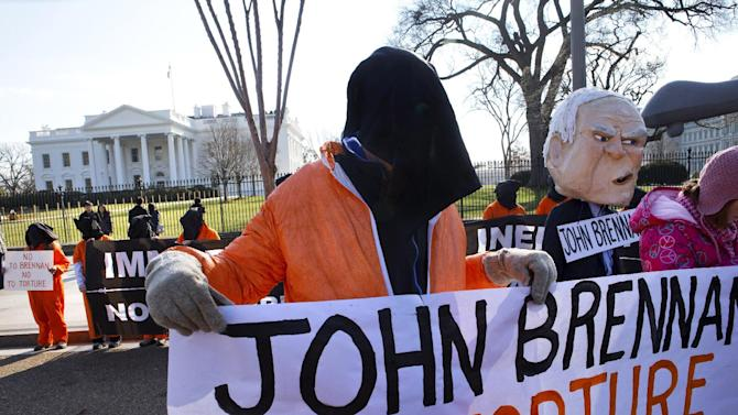 Demonstrators from the groups CodePink and Witness Against Torture protest President Barack Obama's choice of current Deputy National Security Adviser for Homeland Security and Counterterrorism John Brennan to head the CIA, Monday, Jan. 7, 2013, in front of the White House in Washington. (AP Photo/Jacquelyn Martin)