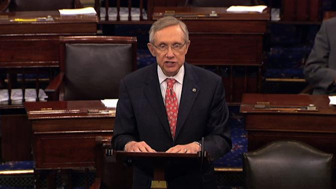 """In this image from Senate television Senate Majority Leader Harry Reid of Nevada, speaks from the floor of the Senate late Saturday, July 30, 2011, at the Capitol in Washington. """"There are many elements to be finalized...there is still a distance to go,"""" Reid cautioned in dramatic late-night remarks on the Senate floor. Still, his disclosure that """"talks are going on at the White House now,"""" coupled with his saying progress had been made, offered the strongest indication yet that a default might be averted.(AP Photo/Senate Television)"""