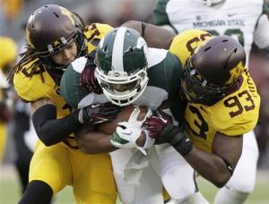 Michigan State beats Minnesota 26-10 for bowl bid