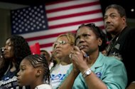 Supporters listen as US President Barack Obama speaks during a campaign event at the Palm Beach County Convention Center in West Palm Beach, Florida, on September 9, 2012. A CNN/ORC survey of likely voters gave Obama 52 percent of the vote compared to 46 percent for Romney, who also fell behind in August in terms of fundraising, the first time he has trailed in the cash race since April