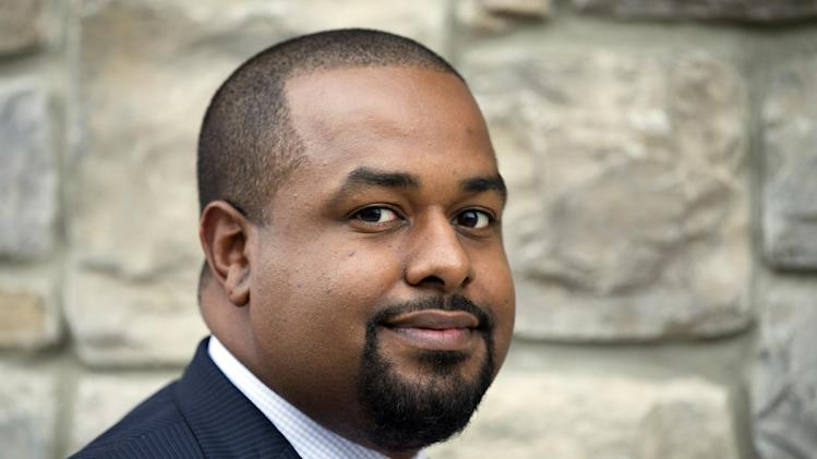 """Joshua DuBois an informal spiritual adviser to President Barack Obama, poses for a photo in northeast Washington, on Wednesday, Oct. 16, 2013. Obama is not an overtly religious man. He and his family rarely attend church, and he almost never elaborates in public about his own relationship to his Christian faith. But far away from the public eye, his longtime advisers say, the president has carefully nurtured a sense of spirituality that has served as a grounding mechanism during turbulent times, when the obstacles to governing a deeply divided nation seem nearly insurmountable. """"I've certainly seen the president's faith grow in his time in office,"""" said DuBois. (AP Photo/Manuel Balce Ceneta)"""