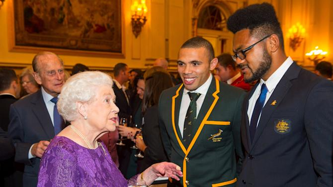 Britain's Queen Elizabeth and the Duke of Edinburgh meet with players at a Rugby World Cup reception at Buckingham Palace
