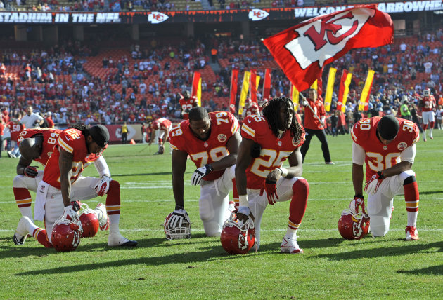 KANSAS CITY, MO - DECEMBER 02: The Kansas City Chiefs kneel and pray before a game against the Carolina Panthers on December 2, 2012 at Arrowhead Stadium in Kansas City, Missouri. (Photo by Peter Aike