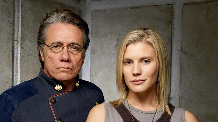 "Edward James Olmos as Admiral William Adama and Katee Sackhoff as Kara ""Starbuck"" Thrace in Battlestar Galactica on the Sci Fi Channel."