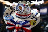 <p>A Democrat from Texas wears a cowboy hat decorated with campaign buttons during the final day of the Democratic National Convention, September 6, 2012 in Charlotte, North Carolina. Obama accepted the Democratic Party's nomination for a second time, dispensing hard truths on US economic ills and warning that Republican Mitt Romney would endanger America abroad.</p>