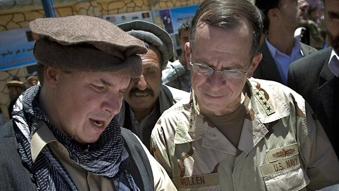 """FILE - In this July 15, 2009 file photo released by Department of Defense, """"Three Cups of Tea"""" co-author Greg Mortenson, left, shows the locations of future village schools to U.S. Navy Adm. Mike Mullen, chairman of the Joint Chiefs of Staff, at the opening of Pushghar Village Girls School in Afghanistan. The charity co-founded by Mortenson named seven new board members as part of a settlement with Montana regulators over accusations the """"Three Cups of Tea"""" author mismanaged it. The Central Asia Institute announced Thursday July 19, 2012, that the new board members were named during a meeting in San Francisco last week.(AP Photo/Department of Defense, U.S. Navy Petty Officer 1st Class Chad J. McNeeley, File)"""