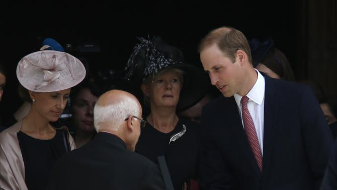 Britain's Prince William shakes hands with a priest as he leaves St John's Co-Cathedral after High Mass in Valletta