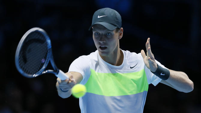 Tomas Berdych of Czech Republic plays a return to Novak Djokovic of Serbia during their ATP World Tour Finals singles tennis match at the O2 Arena in London, Friday, Nov. 9, 2012. (AP Photo/Kirsty Wigglesworth)