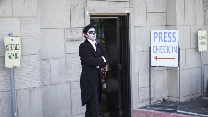 An attendant waits at a press reception ahead of the 15th annual Dia de los Muertos, or Day of the Dead, festival at Hollywood Forever Cemetery in Los Angeles