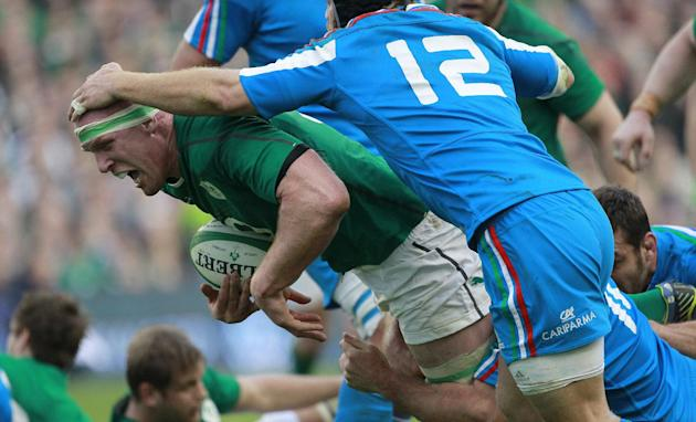 Ireland's Paul O'Connell is tackled by Italy's Gonzalo Garcia, right, during their Six Nations Rugby Union international match at the Aviva Stadium, Dublin, Ireland, Saturday, March 8, 201
