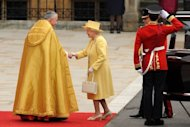 Britain's Queen Elizabeth II shakes hands with the Dean of Westminster
