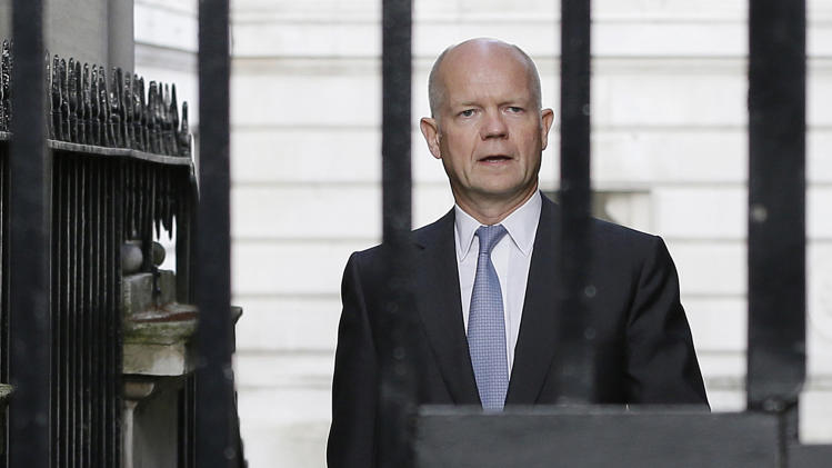Britain' Foreign Secretary William Hague walks to Downing Street ahead of a national security meeting to be held at the Cabinet office with Prime Minister David Cameron on the situation in Syria, in London, Wednesday, Aug. 28, 2013. The U.S. and international partners were unlikely to undertake military action before Thursday. That's when Cameron will convene an emergency meeting of Parliament, where lawmakers were expected to vote on a motion clearing the way for a British response. (AP Photo/Alastair Grant)