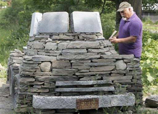 Chris Miller works on his sculpture of a pickup truck made from fieldstone and granite in his yard in Calais, Vt. on Tuesday, June 19, 2012. He has worked on it for about a month, using about 50,000 p