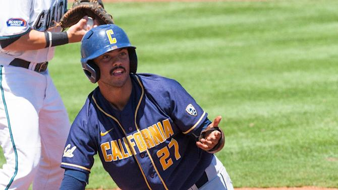 California outfielder Devin Pearson (27) reacting after being picked off at first base by the pitcher Coastal Carolina pitcher Shane Sawczak (38) in the first inning at the College Station Regional baseball tournament in College Station, Texas, Friday, May 29, 2015. (AP Photo/Juan DeLeon}