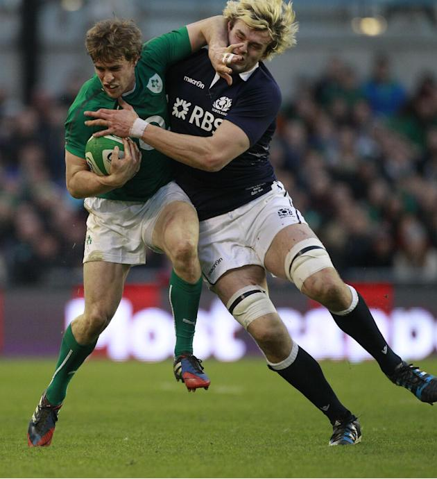Ireland's Andrew Trimble, left, is tackled by Scotland's Richie Gray during their Six Nations Rugby Union international match at the Aviva Stadium, Dublin, Ireland, Sunday, Feb. 2, 2014. (AP P