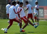 Benfica's Argentinian midfielder Enzo Perez controls the ball during a training session at Benfica's training camp in Seixal, on the outskirts of Lisbon, on the eve of their UEFA Champions League football match against Barcelona