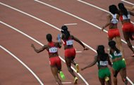 Sprinters are seen competing in the women&#39;s 4x100m relay heats at the athletics event during the London 2012 Olympic Games, on August 9. The final is taking place on Friday, with the USA team leading the qualifying times