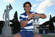 ROME, ITALY - MAY 19:  Rafael Nadal of Spain poses for a photo in front of the statues of Pietrangeli court after his straight sets victory against Roger Federer of Switzerland in their final match during day eight of the Internazionali BNL d'Italia 2013 at the Foro Italico Tennis Centre  on May 19, 2013 in Rome, Italy.  (Photo by Clive Brunskill/Getty Images)