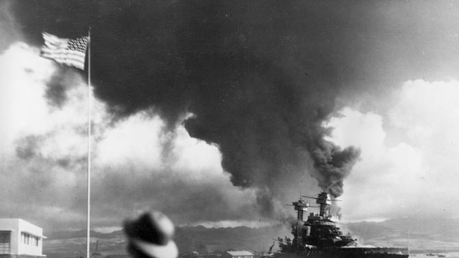 FILE - In this Dec. 7, 1941 file photo, American ships burn during the Japanese attack on Pearl Harbor, Hawaii. (AP Photo)