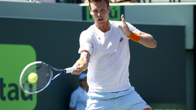 CORRECTS THE DAY AND DATE - Tomas Berdych, of the Czech Republic, returns the ball to Gael Monfils, of France, during their match at the Miami Open tennis tournament in Key Biscayne, Fla., Tuesday, March 31, 2015. (AP Photo/J Pat Carter)