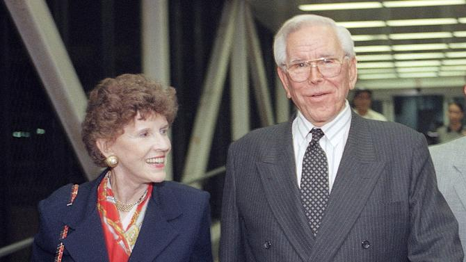 FILE - This Aug. 13, 1997 file photo shows the Rev. Robert Schuller of the Crystal Cathedral, and his wife, Arvella, at Los Angeles International Airport in Los Angeles.  Dr. and Mrs. Robert H. Schuller have announced Saturday, March 10, 2012, their resignation from the board of directors of the Crystal Cathedral Ministries that they founded 42 years ago, fifteen years after starting the Garden Grove Community Church.(AP Photo/John Hayes, File)