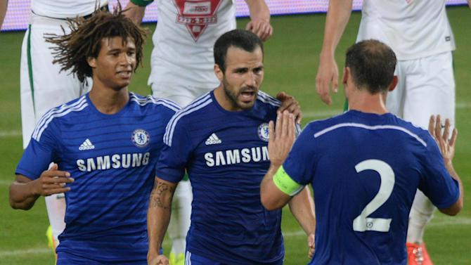 Chelsea's Cesc Fabregas (C) congratulated by teammates after scoring a goal at the Groupama Arena new football stadium in Budapest on August 10, 2014