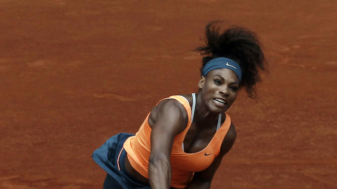 Serena Williams from U.S. serves to Lourdes Dominguez Lino from Spain during their match at the Madrid Open tennis tournament, in Madrid, Tuesday May 7, 2013. (AP Photo/Andres Kudacki)